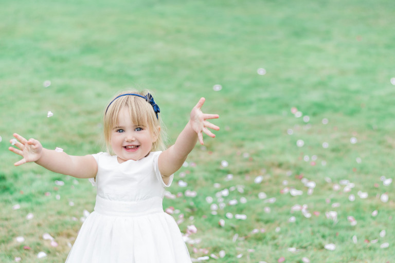 flowergirl throwing confetti